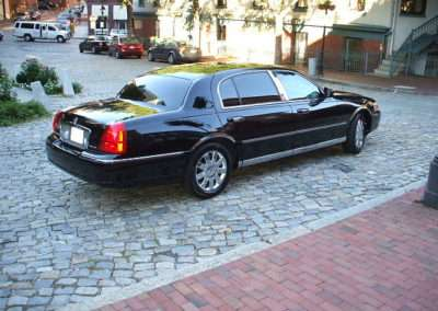 Back view of black limousine.