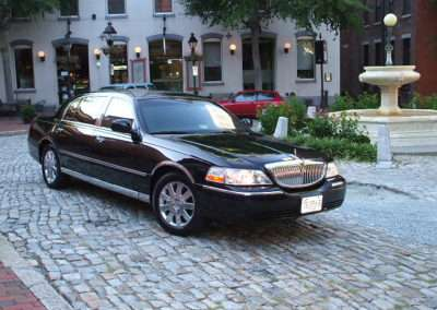 Picture of Tripps Travel Limousine. Black Lincoln Town car 4 doors..